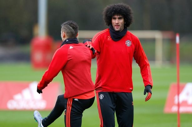 Fellaini gets a helping hand from teammates Marcos Rojo as he takes his first steps. (Photo: Getty Images)